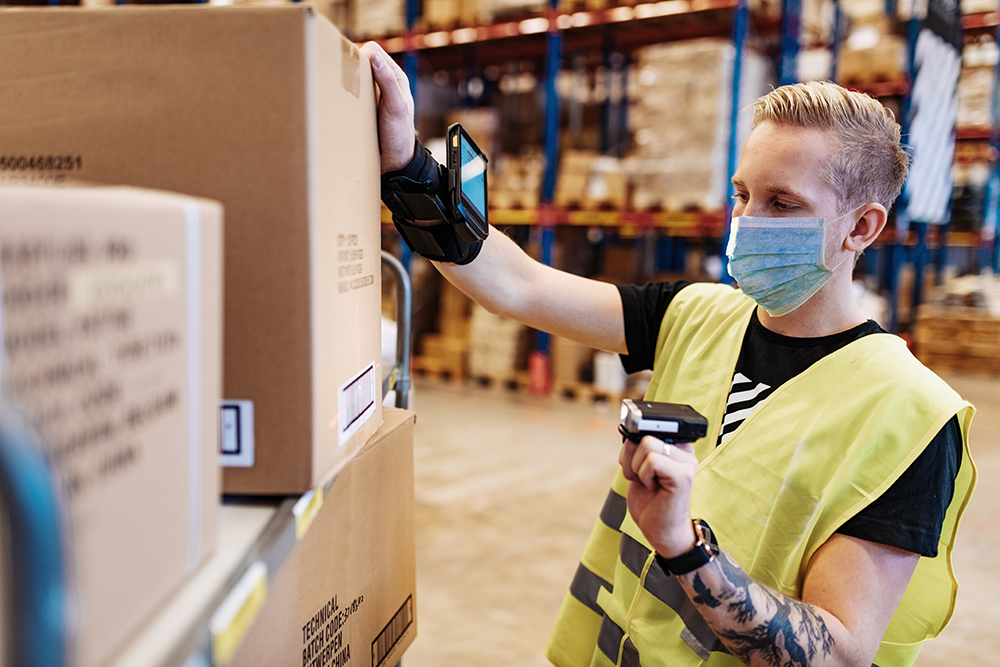 Warehouse staff wearing a face mask for personal protection.