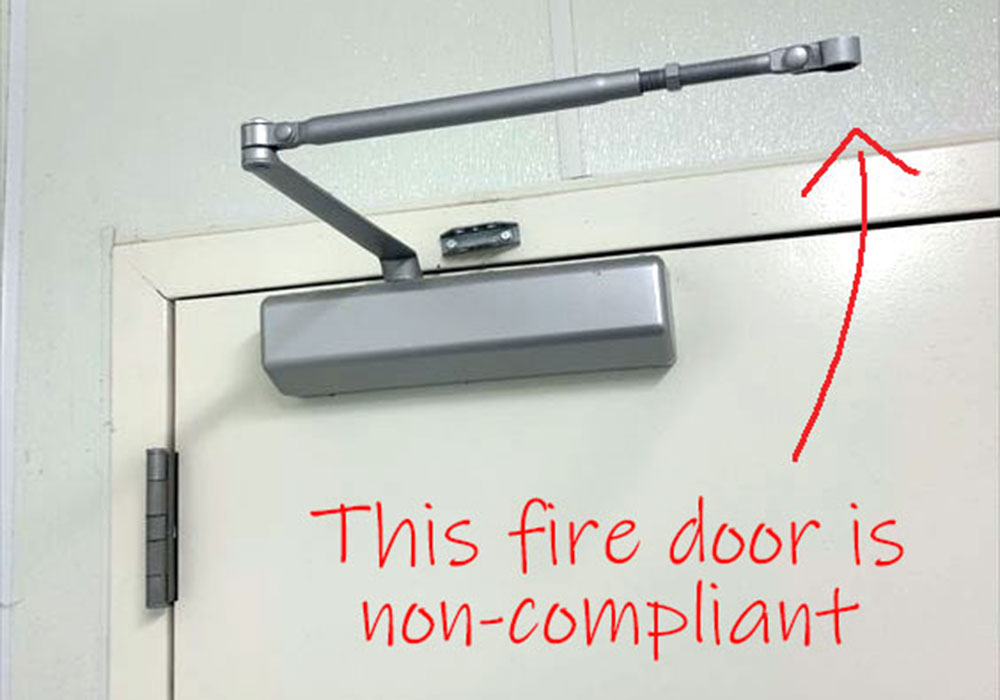 Disengaged fire door closer, not complying with fire door regulations