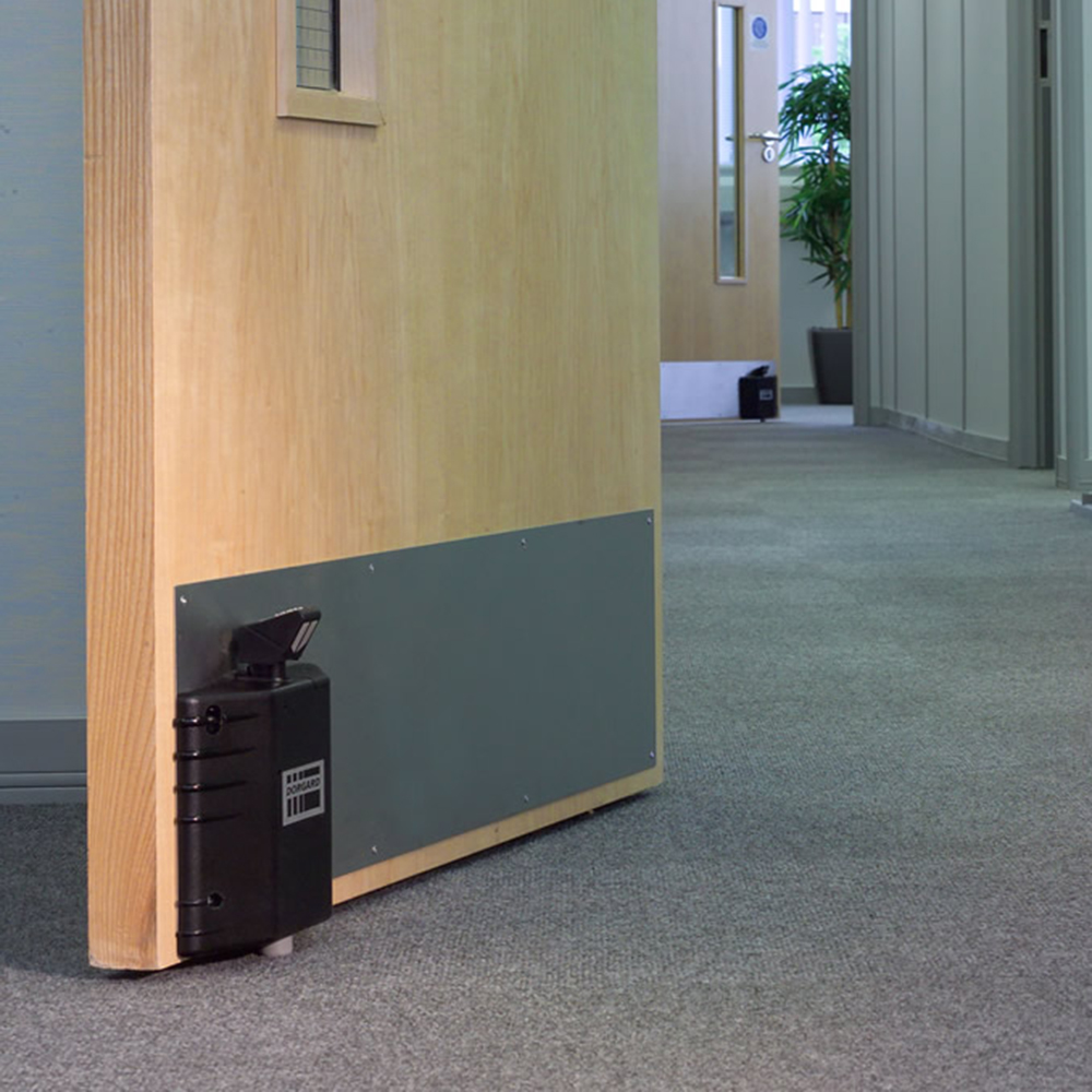 Dorgard fire door retainer on door