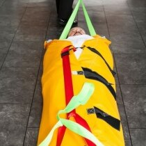 The ResQmat secures the patient in place with three wide velcro straps