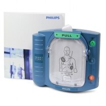 Philips HeartStart HS1 shown with manual