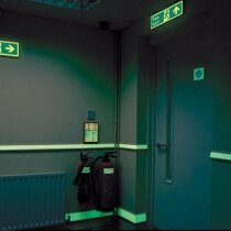 Photoluminescent Water-Based Paint System highlighting fire exits and signs in the dark