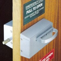 Pull release for use with Cooper Bolt Panic Bolts Outward Opening in use, installed on a door