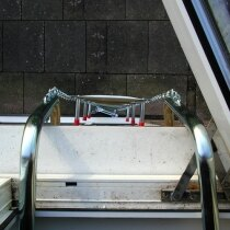 View out of window onto fire escape ladder