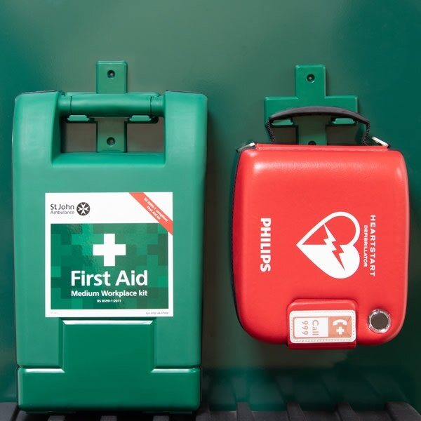 First Aid Kit and Defibrillator on Green Stand
