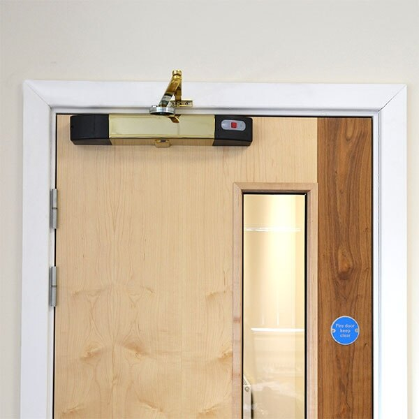 The acoustically activated door closer is also available in polished brass