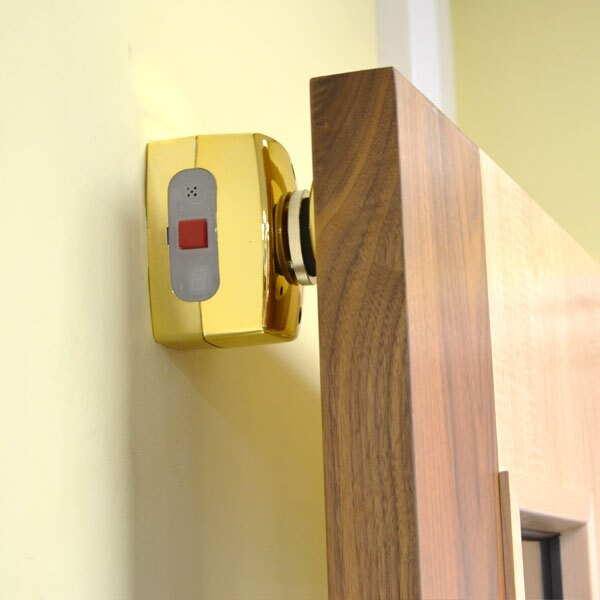 The Agrippa door retainer is also available in a polished brass finish