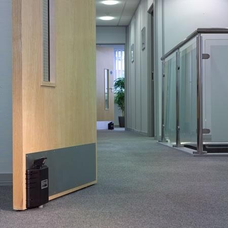 Dorgard Holding Open a Fire Door